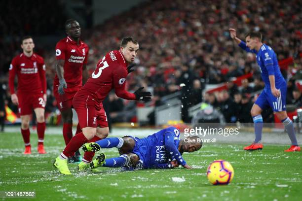 Ricardo Pereira of Leicester City is challenged by Xherdan Shaqiri of Liverpool during the Premier League match between Liverpool FC and Leicester...