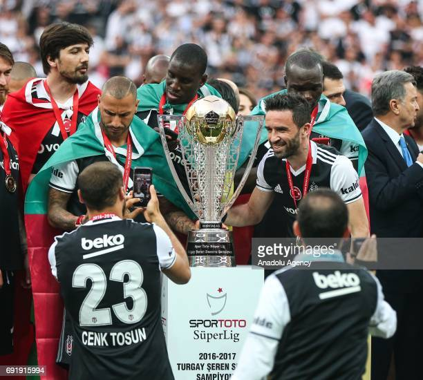 Ricardo Quaresma , Gokhan Gonul and Cenk Tosun of Besiktas take selfies with trophy during the Besiktas' Turkish Super Lig title trophy ceremony at...