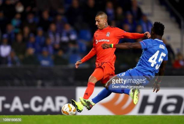 Ricardo Quaresma of Besiktas beats Joseph Aidoo of KRC Genk as he scores his team's first goal during the UEFA Europa League Group I match between...