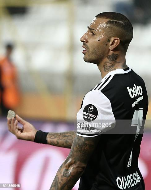 Ricardo Quaresma of Besiktas shows the stone thrown by the fans to the referee during the Turkish Spor Toto Super Lig match between Adanaspor and...