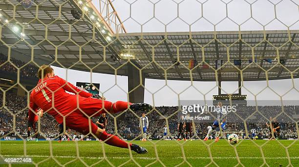 Ricardo Quaresma of FC Porto scores their first goal from the penalty spot past goalkeepr Manuel Neuer of Bayern Muenchen during the UEFA Champions...