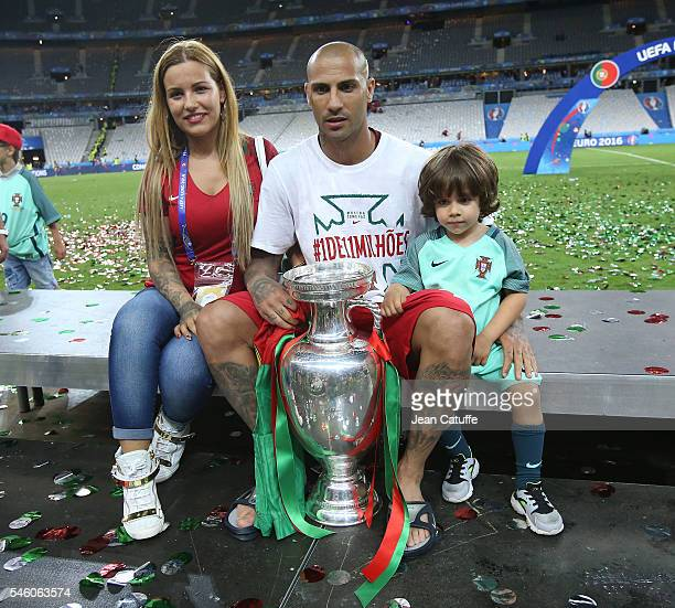Ricardo Quaresma of Portugal and his wife Daphne Quaresma pose with the trophy following the UEFA Euro 2016 final match between Portugal and France...