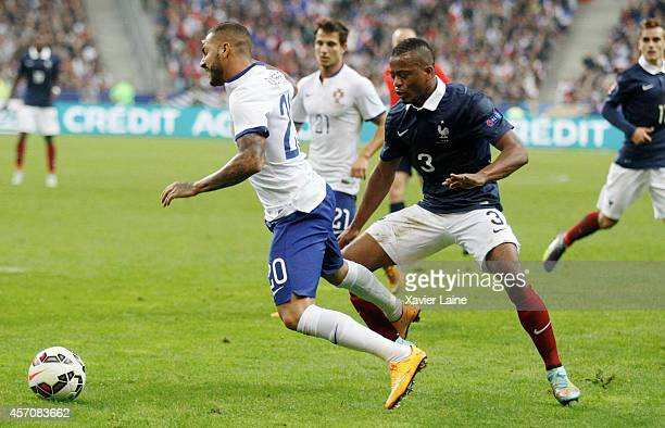 Ricardo Quaresma of Portugal and Patrick Evra of France during the International Friendly Soccer match between France and Portugal at Stade de France...