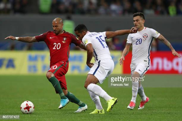 Ricardo Quaresma of Portugal attempts to take the ball past Jean Beausejour of Chile during the FIFA Confederations Cup Russia 2017 SemiFinal between...