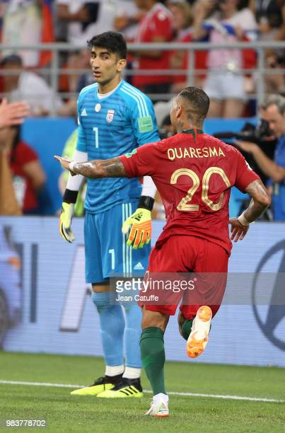 Ricardo Quaresma of Portugal celebrates his goal while goalkeeper of Iran Alireza Beiranvand looks on during the 2018 FIFA World Cup Russia group B...