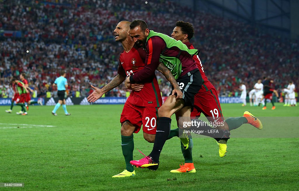 Ricardo Quaresma (L) of Portugal celebrates scoring at the penalty shootout to win the game with his team mates Eduardo (C) and Eliseu (R) during the UEFA EURO 2016 quarter final match between Poland and Portugal at Stade Velodrome on June 30, 2016 in Marseille, France.