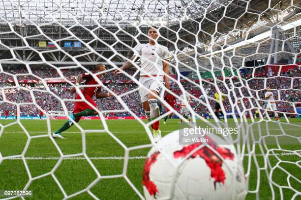 Ricardo Quaresma of Portugal celebrates scoring his sides first goal as Carlos Salcedo of Mexico looks dejected during the FIFA Confederations Cup...