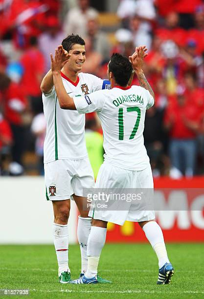 Ricardo Quaresma of Portugal celebrates with Cristiano Ronaldo after scoring his team's third goal during the UEFA EURO 2008 Group A match between...