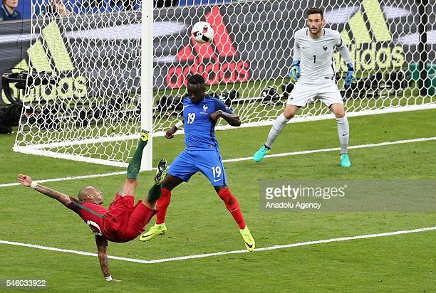 Ricardo Quaresma of Portugal in action against Bacary Sagna and Hugo Lloris of France during the Euro 2016 final match between Portugal and France at...