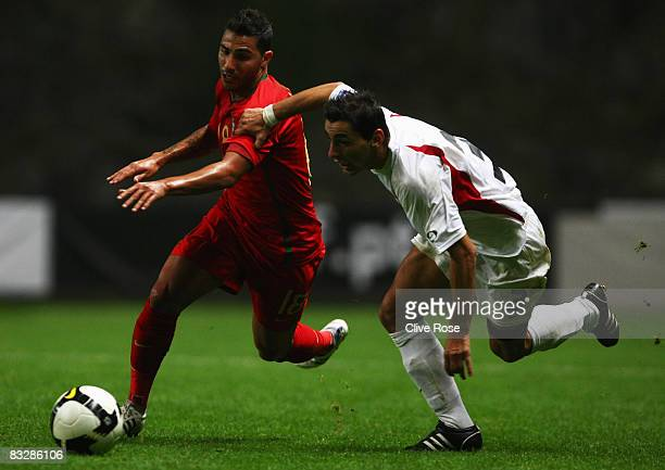 Ricardo Quaresma of Portugal is challanged by Kristi Vangjeli of Albania during the FIFA2010 Group One World Cup Qualifying match between Portugal...