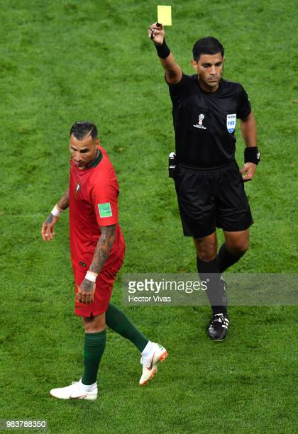 Ricardo Quaresma of Portugal is shown a yellow card by referee Enrique Caceres during the 2018 FIFA World Cup Russia group B match between Iran and...