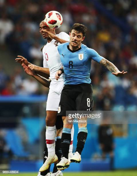 Ricardo Quaresma of Portugal vies with Nahitan Nandez of Uruguay during the 2018 FIFA World Cup Russia Round of 16 match between Uruguay and Portugal...