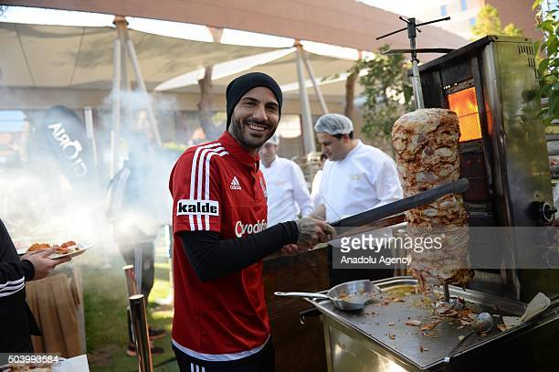 Ricardo Querasma of Besiktas poses for a picture in front of doner kebab stand during Besiktas team's barbecue party for journalists in Antalya...