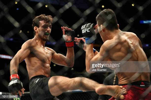 Artes marciales mixtas (MMA, UFC, vale todo) Ricardo-ramos-kicks-kyung-ho-kang-in-the-second-round-in-the-bout-picture-id1011135562?s=612x612
