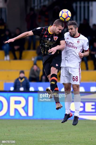 Ricardo Rodríguez of Milan is challenged by George Puca of Benevento during the Serie A match between Benevento and Milan at Ciro Vigorito Stadium...