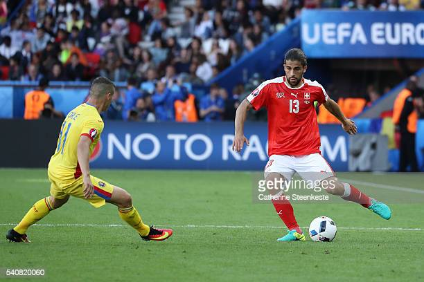 Ricardo Rodríguez of Switzerland controls the ball against Gabriel Torje of Romania during the UEFA EURO 2016 Group A match between Romania and...