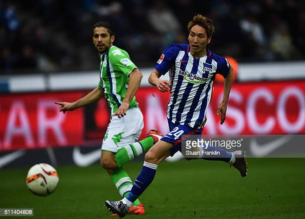 Ricardo Rodríguez of Wolfsburg is challenged by Genki Haraguchi of Berlin during the Bundesliga match between Hertha BSC and VfL Wolfsburg at...
