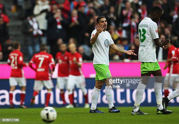 Ricardo Rodríguez of Wolfsburg reacts after the first goal during the Bundesliga match between Bayern Muenchen and VfL Wolfsburg at Allianz Arena on...