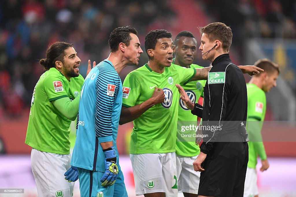 Ricardo Rodriguez, goalkeeper Diego Benaglio, Luiz Gustavo and Joshua Guilavogui of Wolfsburg argue with referee Daniel Siebert during the Bundesliga match between FC Ingolstadt 04 and VfL Wolfsburg at Audi Sportpark on November 26, 2016 in Ingolstadt, Germany.