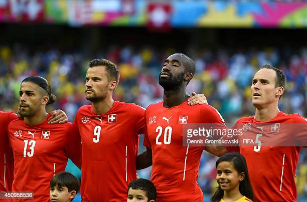 Ricardo Rodriguez Haris Seferovic Johan Djourou and Steve von Bergen of Switzerland line up for the national anthem prior to the 2014 FIFA World Cup...