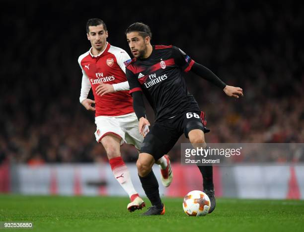 Ricardo Rodriguez of AC Milan breaks away from Henrikh Mkhitaryan of Arsenal during the UEFA Europa League Round of 16 Second Leg match between...