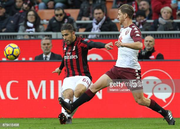 Ricardo Rodriguez of AC Milan competes for the ball with Cristian Ansaldi of Torino FC during the Serie A match between AC Milan and Torino FC at...