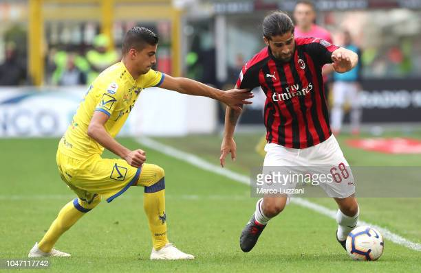 Ricardo Rodriguez of AC Milan competes for the ball with Fabio Depaoli of Chievo Verona during the Serie A match between AC Milan and Chievo Verona...