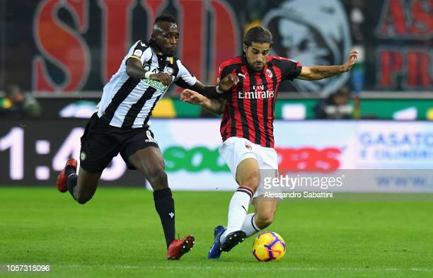 Ricardo Rodriguez of AC Milan competes for the ball with Seko Fofana of Udinese Calcio during the Serie A match between Udinese and AC Milan at...