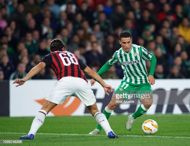 Ricardo Rodriguez of AC Milan duels for the ball with Cristian Tello of Real Betis during the UEFA Europa League Group F match between Real Betis and...