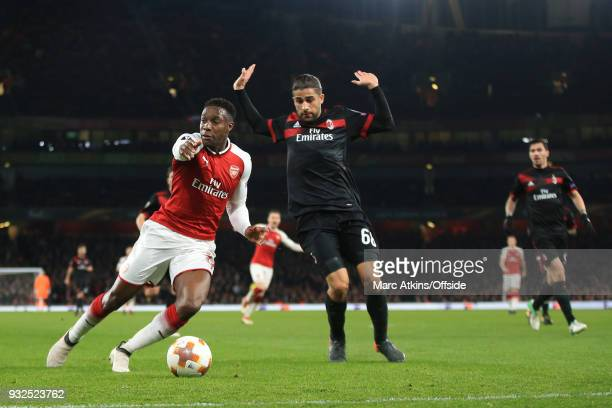 Ricardo Rodriguez of AC Milan fouls Danny Welbeck of Arsenal resulting in a penalty during the UEFA Europa League Round of 16 2nd leg match between...