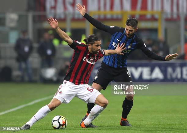 Ricardo Rodriguez of AC Milan is challenged by Roberto Gagliardini of FC Internazionale during the erie A match between AC Milan and FC...