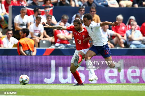 Ricardo Rodriguez of Switzerland battles for possession with Trent AlexanderArnold of England during the UEFA Nations League Third Place Playoff...