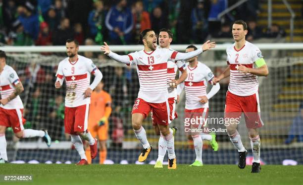 Ricardo Rodriguez of Switzerland celebrates after scoring a penalty during the FIFA 2018 World Cup Qualifier PlayOff first leg between Northern...