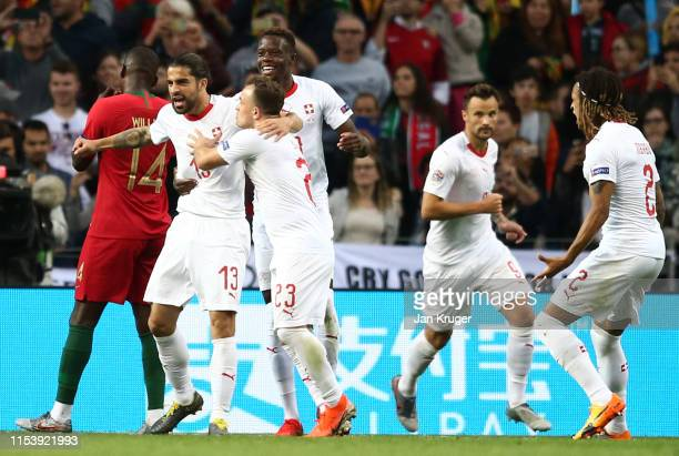 Ricardo Rodriguez of Switzerland celebrates after scoring his team's first goal from a penalty with team mates during the UEFA Nations League...