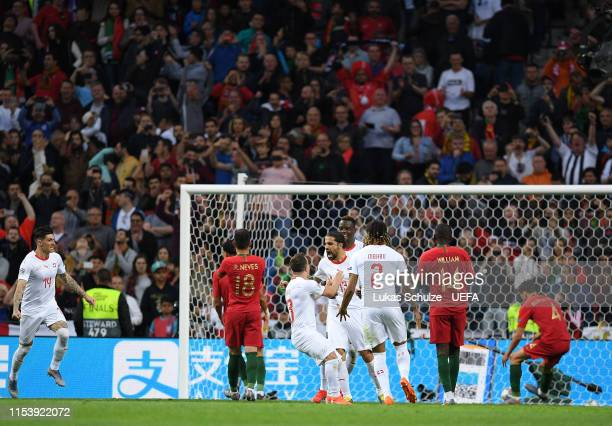 Ricardo Rodriguez of Switzerland celebrates as he scores his sides first goal during the UEFA Nations League Semi-Final match between Portugal and...