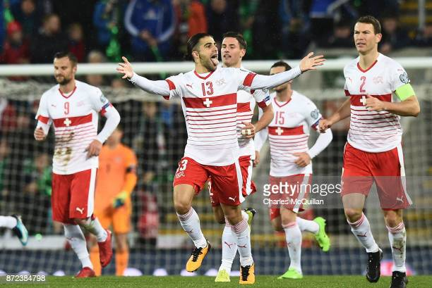 Ricardo Rodriguez of Switzerland celebrates with team mates after scoring from a penalty during the FIFA 2018 World Cup Qualifier PlayOff first leg...