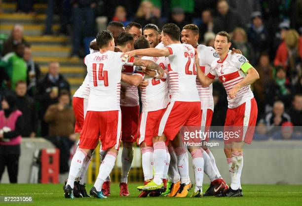Ricardo Rodriguez of Switzerland celebrates with team mates after he scores his sides first goal during the FIFA 2018 World Cup Qualifier PlayOff...