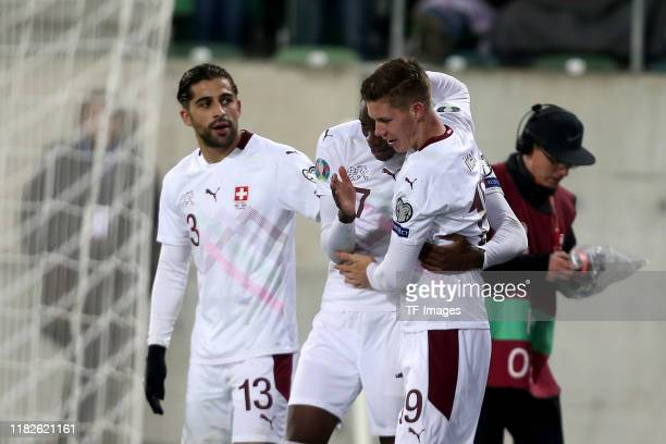 Ricardo Rodriguez of Switzerland Denis Zakaria of Switzerland and Cedric Itten of Switzerland celebrates after scoring his team's first goal with...