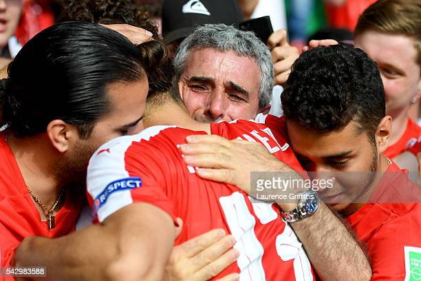 Ricardo Rodriguez of Switzerland is consoled by supporters after the UEFA EURO 2016 round of 16 match between Switzerland and Poland at Stade...