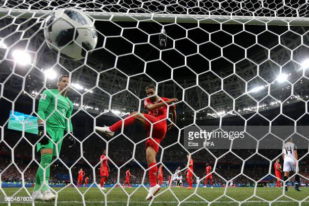 Ricardo Rodriguez of Switzerland kicks the ball into the back of the net in frustration after Switzerland concede a late penalty during the 2018 FIFA...