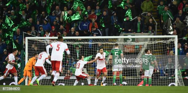 Ricardo Rodriguez of Switzerland scores from a penalty during the FIFA 2018 World Cup Qualifier PlayOff first leg between Northern Ireland and...