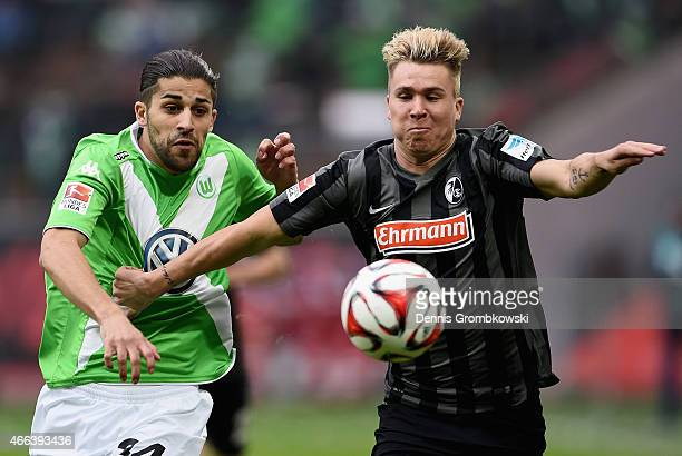 Ricardo Rodriguez of VfL Wolfsburg and Felix Klaus of SC Freiburg battle for the ball during the Bundesliga match between VfL Wolfsburg and SC...