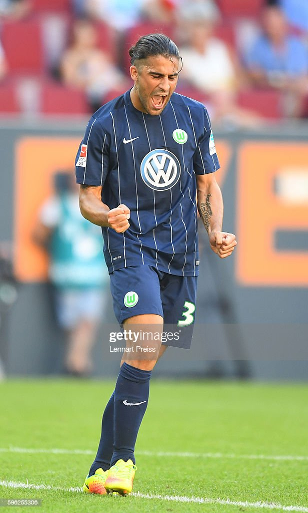 Ricardo Rodriguez of VfL Wolfsburg celebrates his team's second goal during the Bundesliga match between FC Augsburg and VfL Wolfsburg at WWK Arena on August 27, 2016 in Augsburg, Germany.
