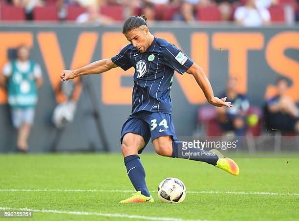 Ricardo Rodriguez of VfL Wolfsburg scores his team's second goal during the Bundesliga match between FC Augsburg and VfL Wolfsburg at WWK Arena on...