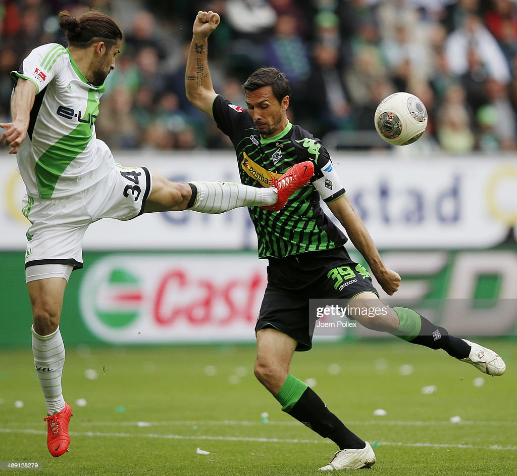 Ricardo Rodriguez (L) of Wolfsburg and Martin Stranzl of Moenchengladbach compete for the ball during the Bundesliga match between at Volkswagen Arena on May 10, 2014 in Wolfsburg, Germany.