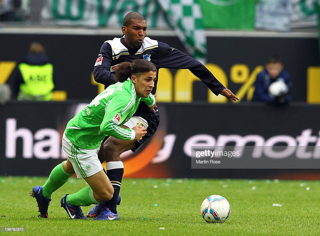 Ricardo Rodriguez (L) of Wolfsburg and Ryan Babel (R) of Hoffenheim battle for the ball during the Bundesliga match between VfL Wolfsburg and 1899 Hoffenheim at the Volkswagen Arena on February 25, 2012 in Wolfsburg, Germany.