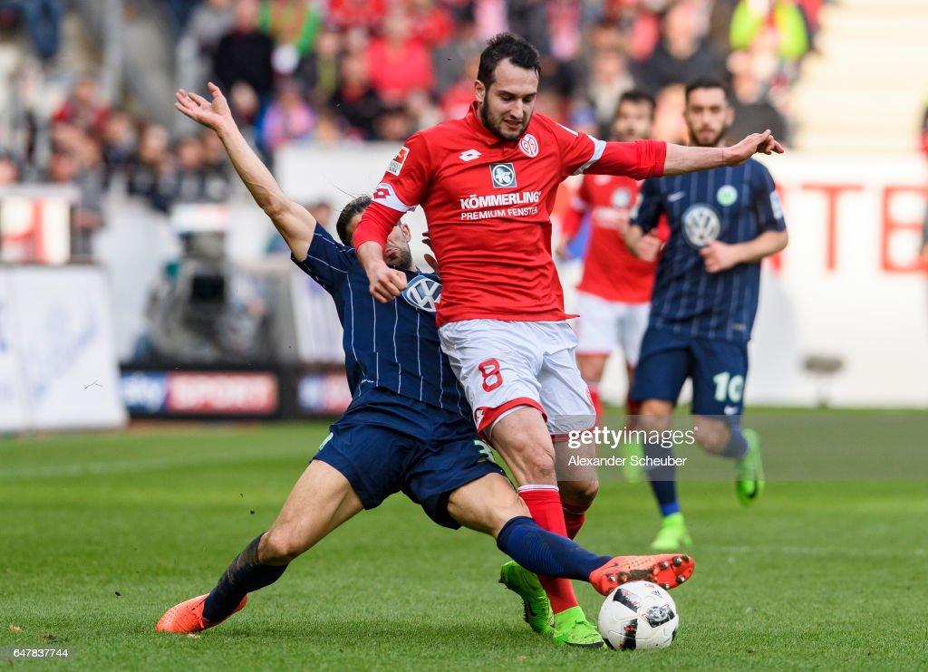 Ricardo Rodriguez of Wolfsburg challenges Levin Oeztunali of Mainz 05 during the Bundesliga match between 1. FSV Mainz 05 and VfL Wolfsburg at Opel Arena on March 4, 2017 in Mainz, Germany.