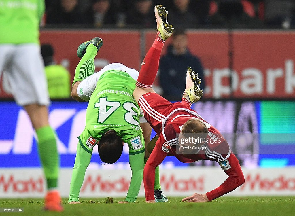 Ricardo Rodriguez (l) of Wolfsburg challenges Moritz Hartmann (r) of Ingolstadt during the Bundesliga match between FC Ingolstadt 04 and VfL Wolfsburg at Audi Sportpark on November 26, 2016 in Ingolstadt, Germany.
