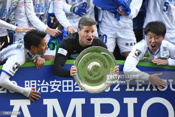 Ricardo Rodriguez,coach of Tokushima Vortis holds the trophy after the J.League Meiji Yasuda J2 match between Avispa Fukuoka and Tokushima Vortis at...