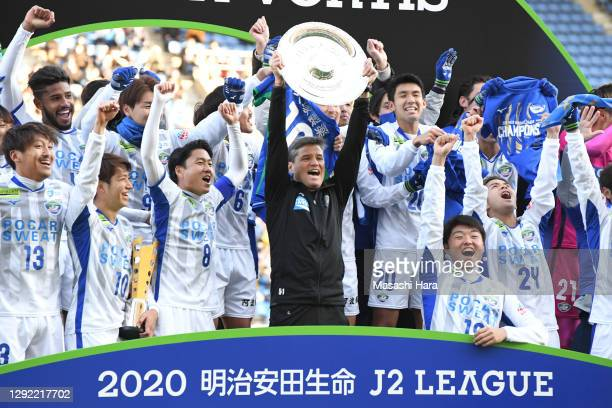 Ricardo Rodriguez,cocah of Tokushima Vortis lifts the trophy after the J.League Meiji Yasuda J2 match between Avispa Fukuoka and Tokushima Vortis at...